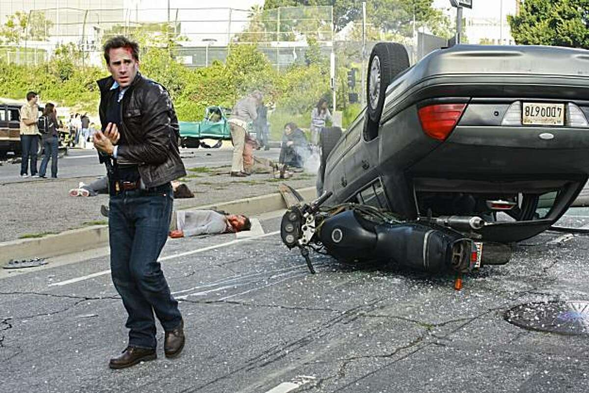 """FLASHFORWARD - """"No More Good Days"""" - On the season premiere episode, """"No More Good Days,"""" it's just another normal day in Los Angeles. FBI agent Mark Benford and his partner, Demetri Noh, are in the middle of a car chase monitored by their boss, Stanford Wedeck, and colleague Janis Hawk; Mark's wife, Dr. Olivia Benford, is in the middle of surgery; Dr. Bryce Varley is weighing a potentially life-ending decision; Mark's friend, Aaron Stark, is working high above the ground on power lines; and Nicole Kirby -- baby-sitter to Mark and Olivia's daughter, Charlie -- is in the throes of passion with her boyfriend when suddenly, and without warning, every person on Earth blacks out for two minutes and seventeen seconds and sees a series of events from their own future, taking place on April 29, 2010 at 10:00 p.m., Pacific Time. For some the future will be joyous and hopeful; for others, shockingly unexpected; and for a few, it simply doesn't seem to exist, on the premiere of """"FlashForward,"""" THURSDAY, SEPTEMBER 24 (8:00-9:00 p.m., ET) on the ABC Television Network. (ABC/RON TOM) JOSEPH FIENNES"""