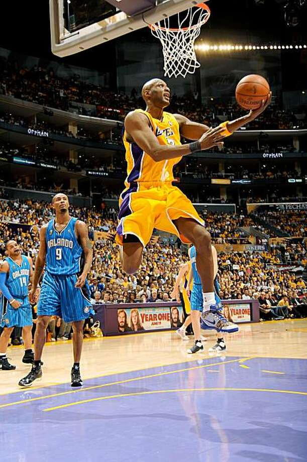 LOS ANGELES - JUNE 4: Lamar Odom #7 of the Los Angeles Lakers shoots against Rashard Lewis #9 of the Orlando Magic during Game One of the 2009 NBA Finals at Staples Center on June 4, 2009 in Los Angeles, California.  NOTE TO USER: User expressly acknowledges and agrees that, by downloading and/or using this Photograph, user is consenting to the terms and conditions of the Getty Images License Agreement. Mandatory Copyright Notice: Copyright 2009 NBAE (Photo by Andrew D. Bernstein/NBAE via Getty Images) Photo: Andrew D. Bernstein, NBAE/Getty Images