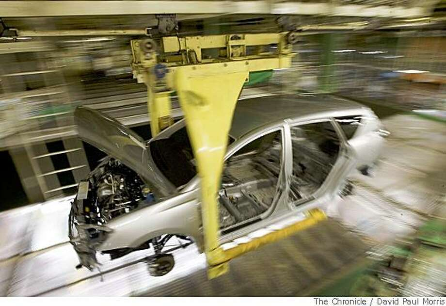 Assembly workers work on the new Toyota Prius inside the Toyota Tsutsumi Plant on March 22, 2006 in Toyota City Japan. Photo: David Paul Morris, The Chronicle