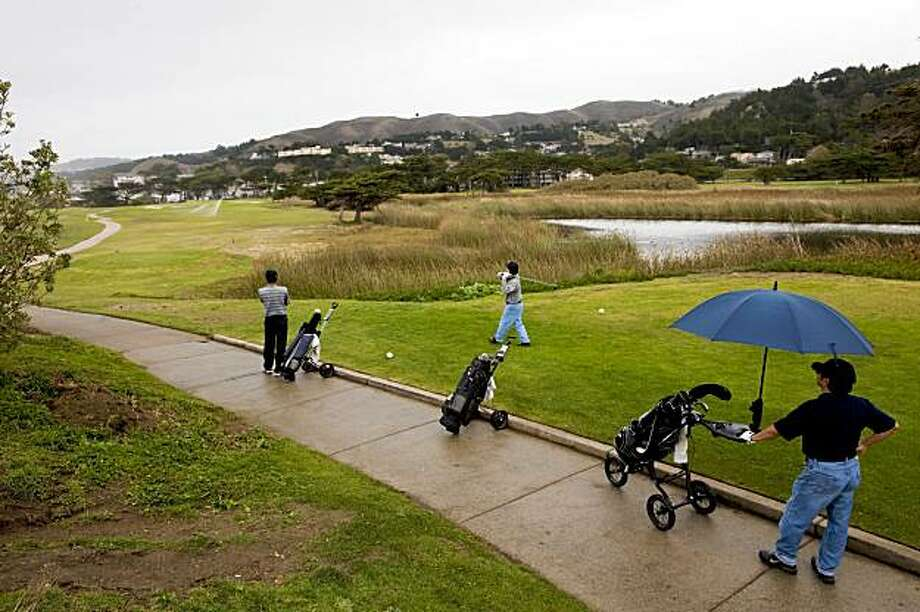 Golfers tee off on the 17th hole as they play golf on the Sharp Park Golf Course November 6, 2009 in Pacifica, Calif.  Photograph by David Paul Morris / Special to the Chronicle Photo: David Paul Morris, The Chronicle