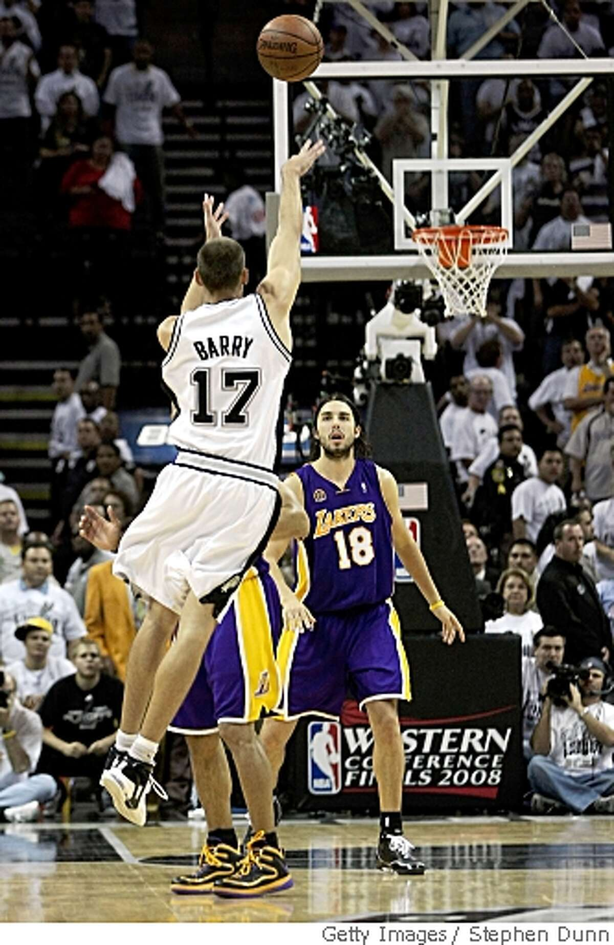 SAN ANTONIO - MAY 27: Brent Barry #17 of the San Antonio Spurs shoots and misses the final shot over Derek Fisher #2 of the Los Angeles Lakers in Game Four of the Western Conference Finals during the 2008 NBA Playoffs on May 27, 2008 at the AT&T Center in San Antonio, Texas. The Lakers defeated the Spurs 93-91 to take a 3-1 series lead. NOTE TO USER: User expressly acknowledges and agrees that, by downloading and/or using this Photograph, user is consenting to the terms and conditions of the Getty Images License Agreement. (Photo by Stephen Dunn/Getty Images)