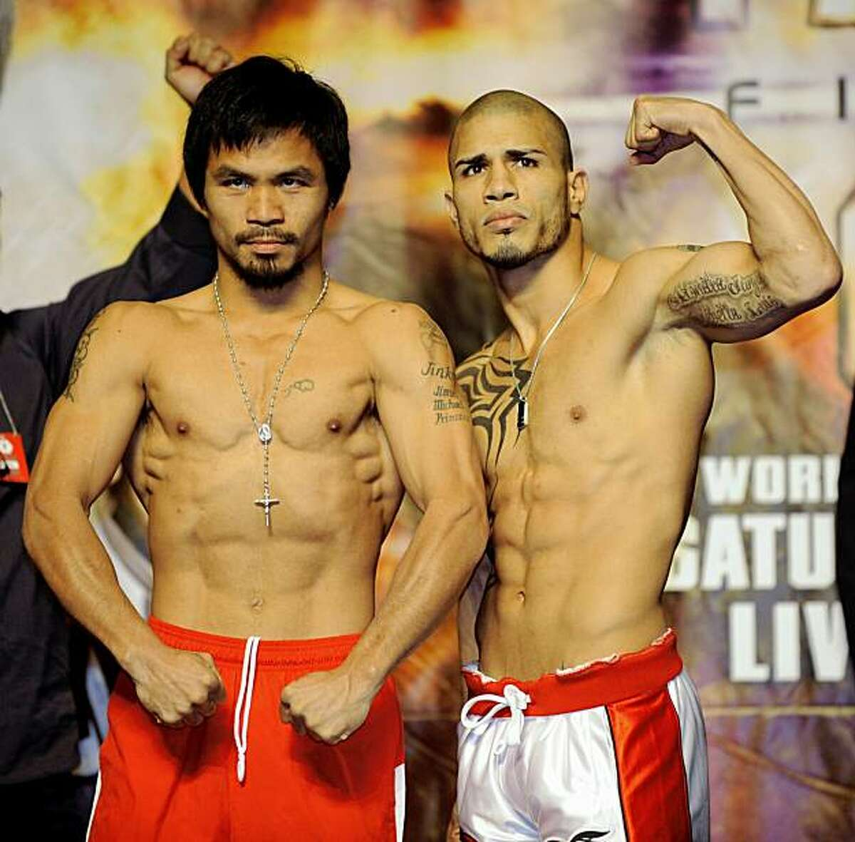 Manny Pacquiao, left, of the Philippines, and Miguel Cotto, of Puerto Rico, pose during the weigh-in for their WBO boxing welterweight title fight Friday, Nov. 13, 2009 in Las Vegas. (AP Photo/Mark J. Terrill)