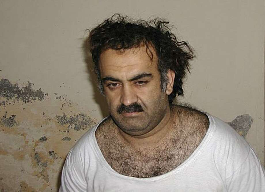 FILE - In this March 1, 2003 file picture, Khalid Sheikh Mohammed is seen shortly after his capture during a raid in Pakistan. An Obama administration official said Friday Nov. 13, 2009 that accused Sept. 11 mastermind Khalid Sheikh Mohammed and four other Guantanamo Bay detainees will be sent to New York to face trial in a civilian federal court.  (AP Photo/File) Photo: Associated Press