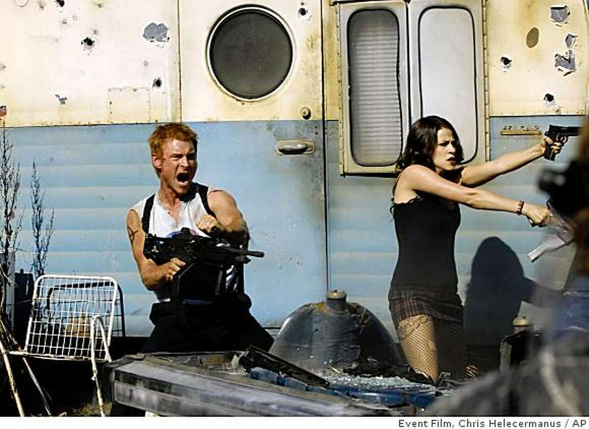 In this image released by Event Film, Zack Ward, left, and Jackie Tohn are shown in a scene from