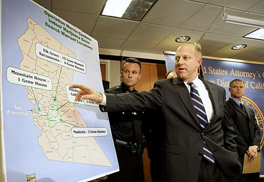 **CORRECTS NUMBER OF LOCATIONS** Lawrence G. Brown, the United States Attorney for the Eastern District of California, gestures to a map showing the locations of 51 Central Valley homes that were converted into high-tech marijuana nurseries,  during a news conference in Sacramento, Calif., Thursday, Oct. 22, 2009.  Brown announced that charges had been filed against 18 people said to be operating a lucrative marijuana-growing operation in the homes  that has an estimated value of nearly $100 million a year.  Seen at left is Elk Grove Police Captain Bryan Noblett. (AP Photo/Rich Pedroncelli) Photo: Rich Pedroncelli, AP