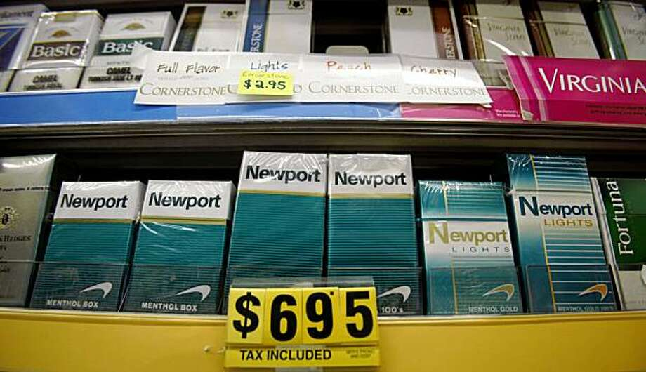 Boxes of Newport cigarettes, a Lorillard brand, are shown at Ashbury Tobacco Center in San Francisco, Monday, Oct. 26, 2009. Lorillard Inc., the nation's third-largest cigarette maker, saw less of a decline in cigarettes sold in the third quarter than its competitors as its value brands posted big gains. (AP Photo/Jeff Chiu) Photo: Jeff Chiu, AP