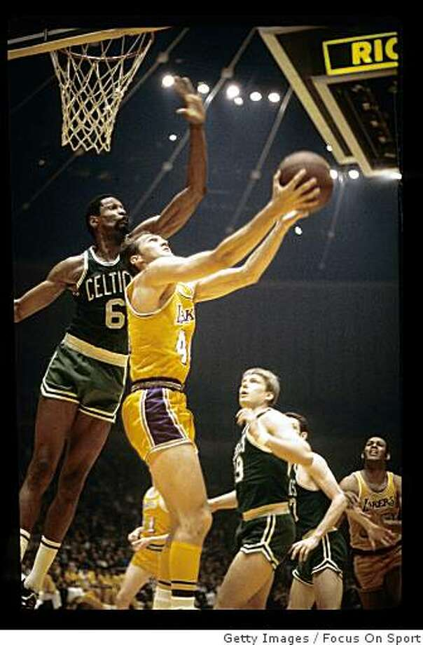LOS ANGELES, CA - CIRCA 1960's:  Jerry West #44 of the Los Angeles Lakers attempts a reverse layup against Bill Russell #6 of the Boston Celtics during a late circa 1960's NBA basketball game in Los Angeles, California. West played for the Lakers from 1960 - 74. (Photo by Focus on Sport/Getty Images) Photo: Focus On Sport, Getty Images