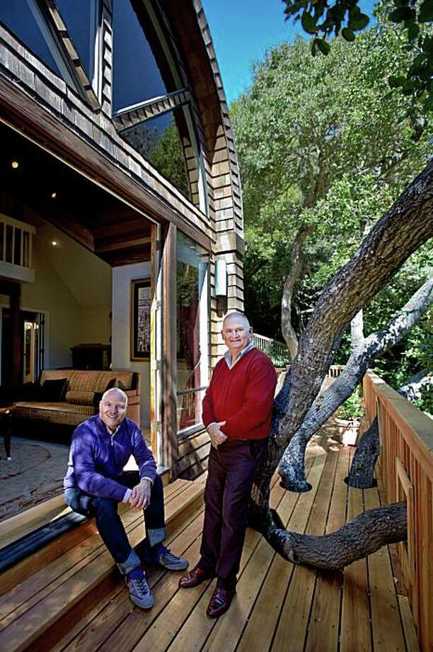 John Capizzi, GM of Neiman Marcus, and his partner, Glenn Riddell (L-R) out on their deck in Sausalito. Photo: Peter DaSilva, Special To The Chronicle
