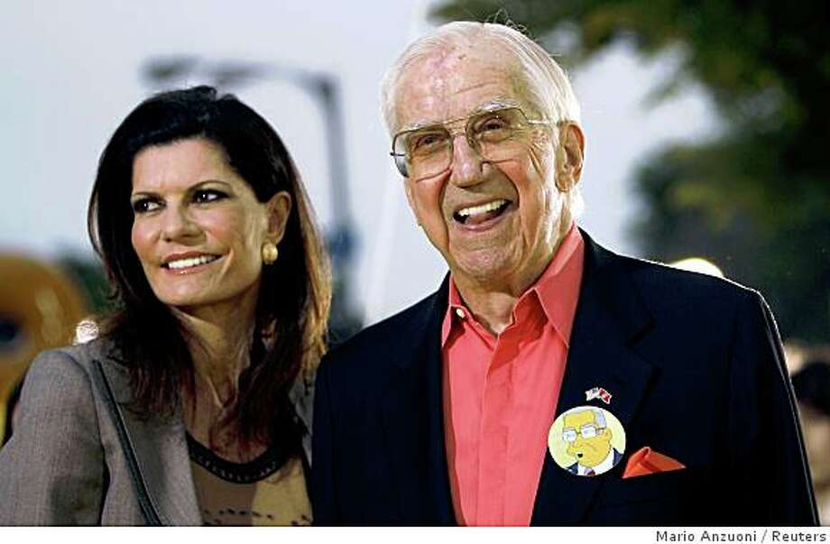 "Celebrity guest voice on the television series ""The Simpsons"" Ed McMahon and his wife Pamela attend the premiere of ""The Simpsons Movie"" in Los Angeles, California in this July 24, 2007 file photograph. McMahon is fighting to save is multi-million dollar Beverly Hills home from foreclosure, according to McMahon's publicist June 4, 2008.  REUTERS/Mario Anzuoni/Files (UNITED STATES) Photo: Mario Anzuoni, Reuters"