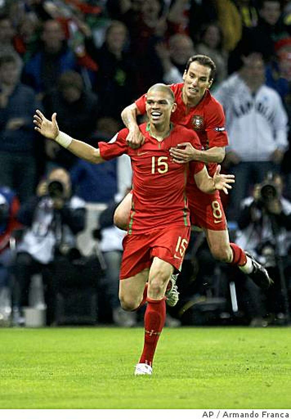 Portugal's Pepe, left, reacts with fellow team member Petit, right, after scoring the opening goal during the group A match between Portugal and Turkey in Geneva, Switzerland, Saturday, June 7, 2008, at the Euro 2008 European Soccer Championships in Austria and Switzerland. (AP Photo/Armando Franca)