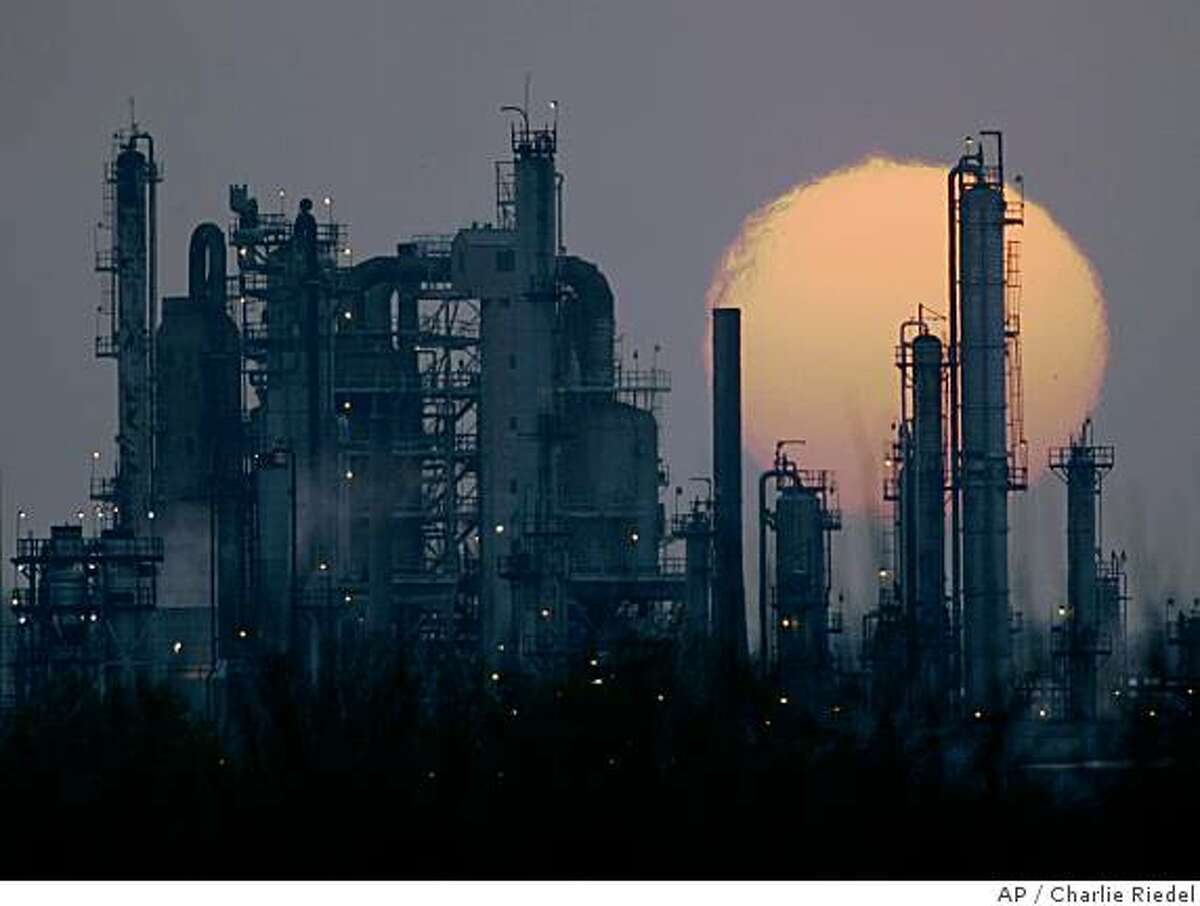 **FILE** In this April 24, 2008 file photo, the Pioneer oil refinery is silhouetted against the setting sun in El Dorado, Kan. as the facility transforms crude oil into gasoline and other petroleum products. Oil prices shot up more than $10 to a new record above $139 Friday after a major investment bank predicted a spike to $150 in the coming weeks and rising tensions in the Middle East left investors uneasy about supply. (AP Photo/Charlie Riede, filel)