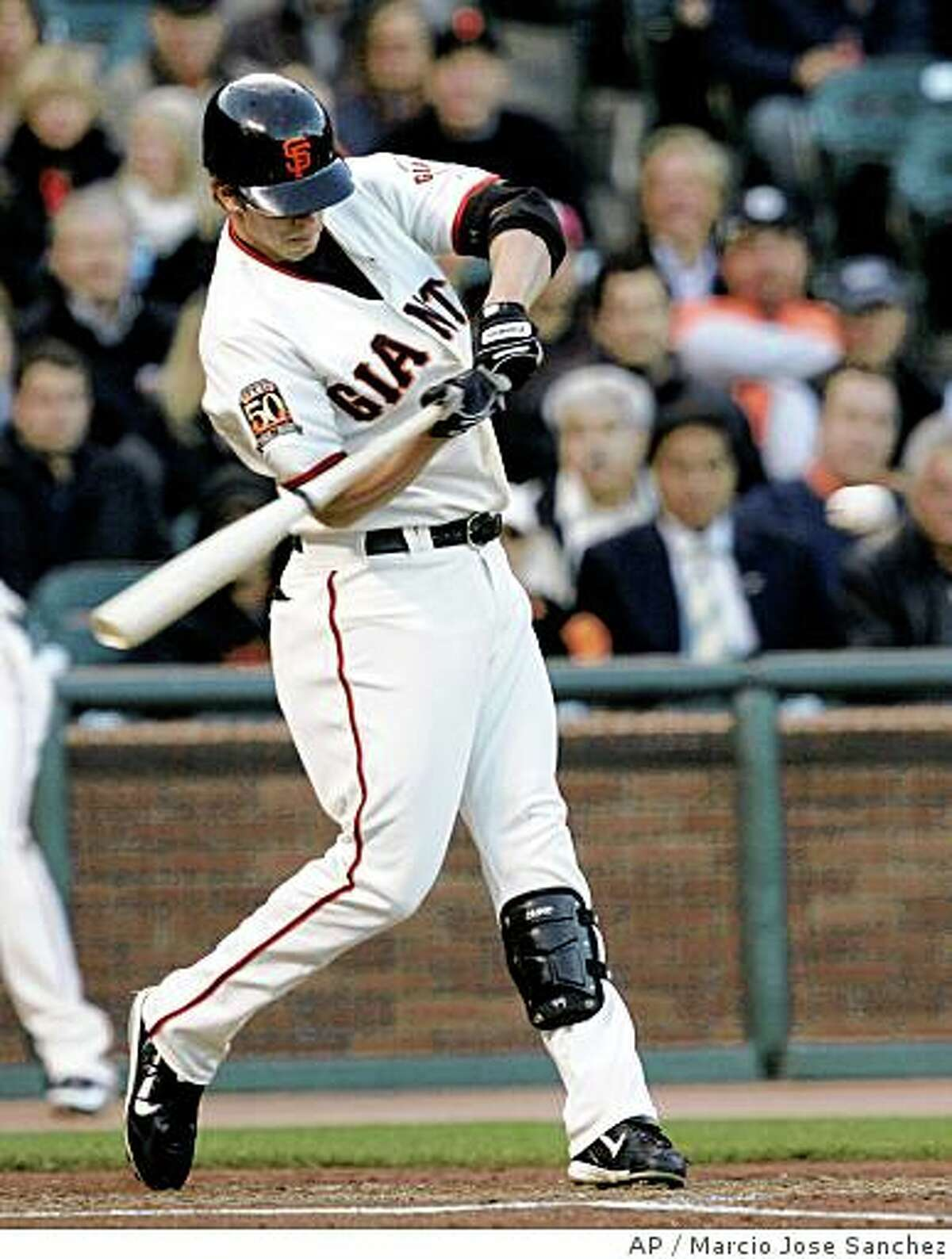 San Francisco Giants' Brian Horwitz hits a two-run home run off New York Mets starting pitcher Oliver Perez in the first inning of a baseball game in San Francisco, Monday, June 2, 2008. (AP Photo/Marcio Jose Sanchez)