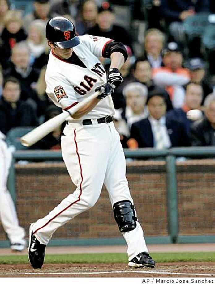 San Francisco Giants' Brian Horwitz hits a two-run home run off New York Mets starting pitcher Oliver Perez in the first inning of a baseball game in San Francisco, Monday, June 2, 2008. (AP Photo/Marcio Jose Sanchez) Photo: Marcio Jose Sanchez, AP