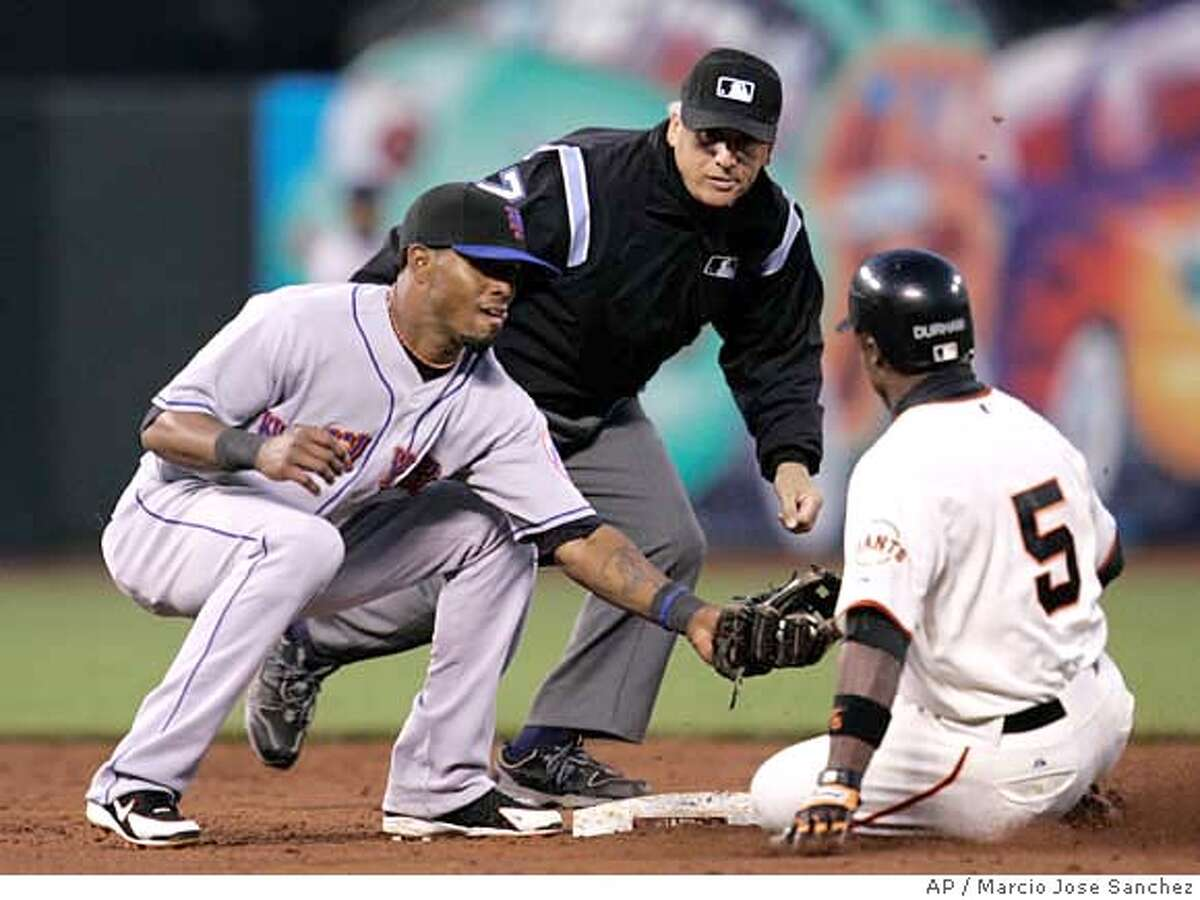 New York Mets shortstop Jose Reyes, left, tags out San Francisco Giants' Ray Durham as Durham tried to stretch a single into a double in the third inning of a baseball game in San Francisco, Monday, June 2, 2008. (AP Photo/Marcio Jose Sanchez)