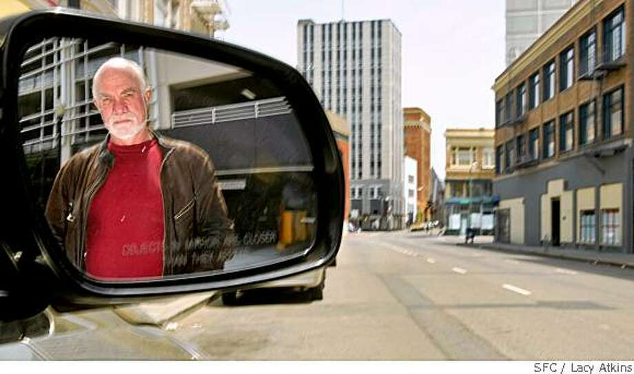 Robert Shank, 59, returns to the scene Sunday May 25, 2008, where he was victimized in a carjacking at the corner of 17th and Telegraph in Oakland, Calif. He was attacked and his car stolen in the early morning hours last January.  He received his car back without any damage to it.Lacy Atkins / San Francisco Chronicle Photo: Lacy Atkins, SFC