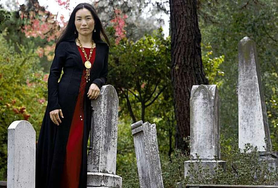 "Author Ying Compestine visits a cemetery in Lafayette, Calif., on Thursday, Oct. 15, 2009. Compestine's latest book, ""Hungry Ghosts,"" profiles stories and feasts about the dead in the Chinese tradition. Photo: Paul Chinn, The Chronicle"