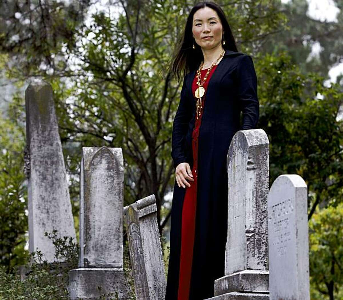 """Author Ying Compestine visits a cemetery in Lafayette, Calif., on Thursday, Oct. 15, 2009. Compestine's latest book, """"Hungry Ghosts,"""" profiles stories and feasts about the dead in the Chinese tradition."""