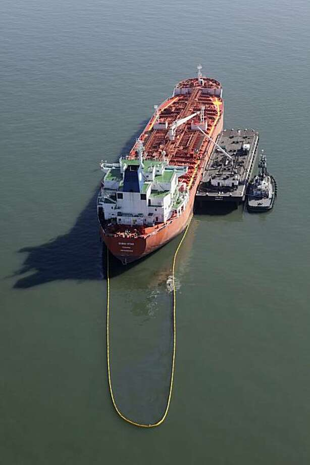 The Dubai Star oil tanker is seen in an aerial view off the coast of San Francisco on Friday, Oct. 30, 2009. The Panamanian-flagged ship began leaking bunker fuel during a fuel transfer Friday morning. (AP Photo/Marcio Jose Sanchez) Photo: Marcio Jose Sanchez, AP
