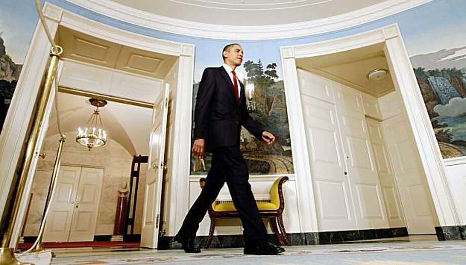 President Barack Obama arrives  in the Diplomatic Reception Room of the White House in Washington, Friday, Oct. 30, 2009,  to sign the Ryan White HIV/AIDS Treatment Extension Act of 2009. (AP Photo/Gerald Herbert) Photo: Gerald Herbert, AP