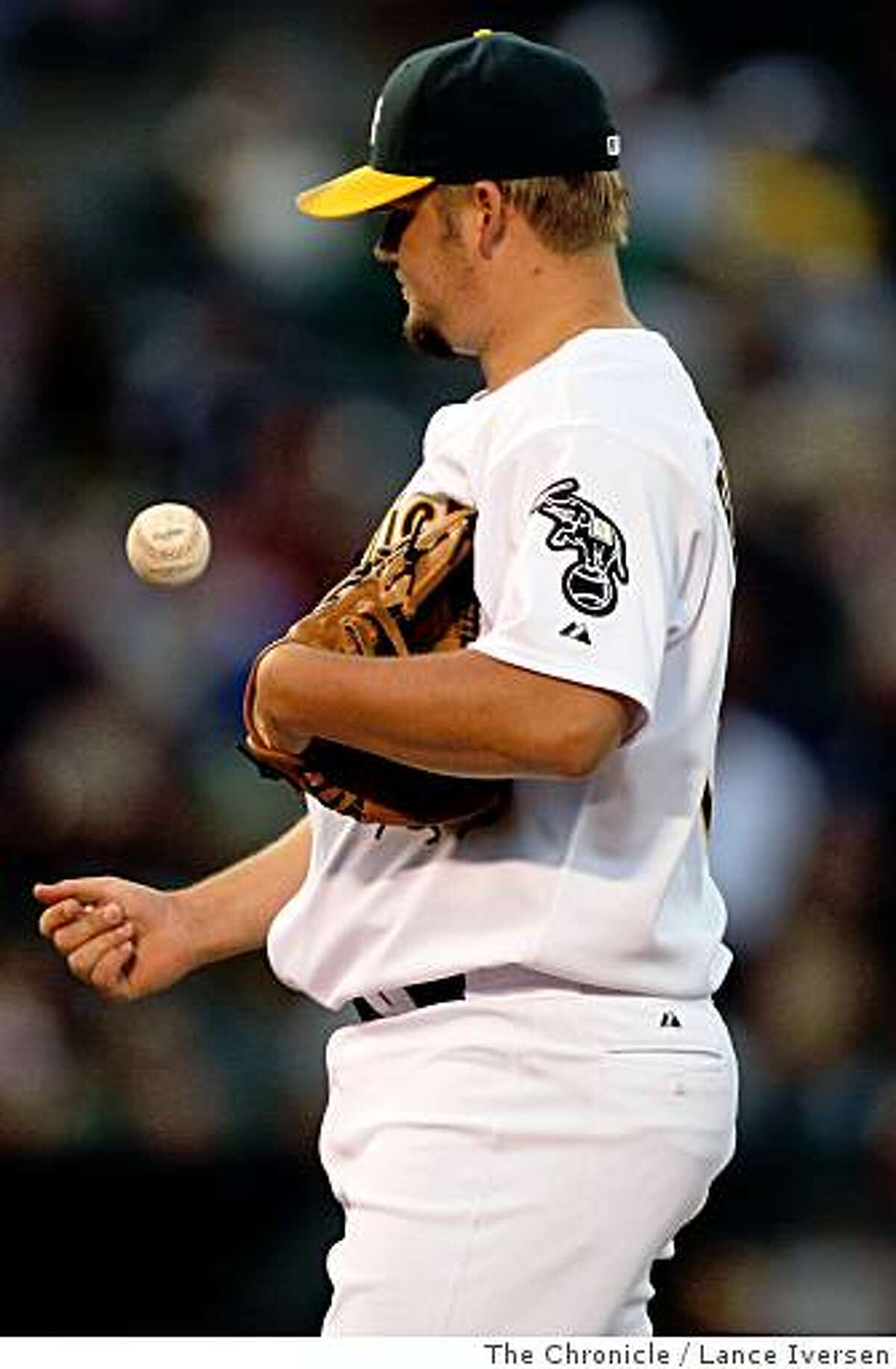 Oakland Athletics' starting pitcher Joe Blanton flips the ball between batters during their game with the Los Angeles Angels at McAfee Coliseum, in Oakland Calif., Friday, June 6, 2008. Photo by Lance Iversen / The Chronicle