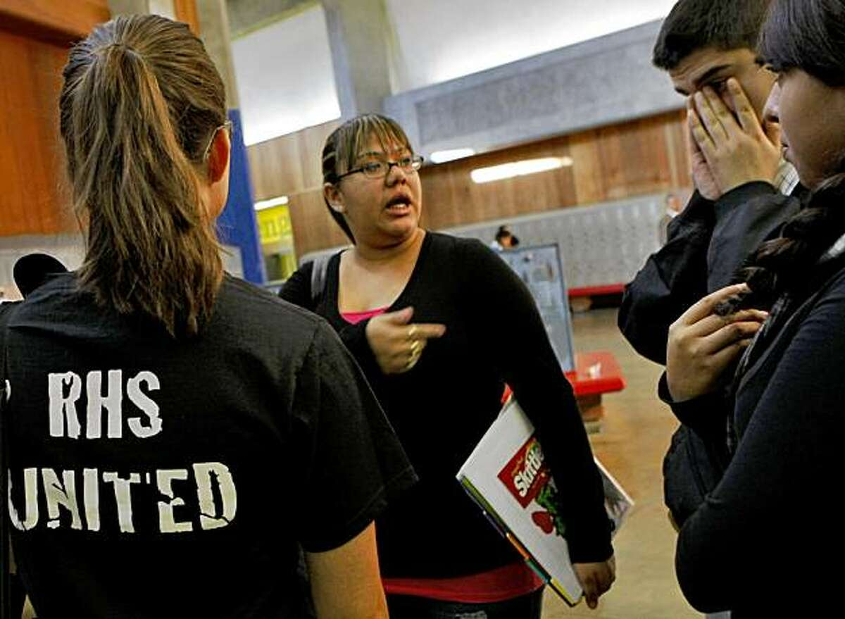 Teacher Jessica Price, left, talks with Carina Contreras and other students who were angry about negative comments that were being made about the victim of the gang rap, Thursday Oct. 29, 2009, in Richmond, Calif.