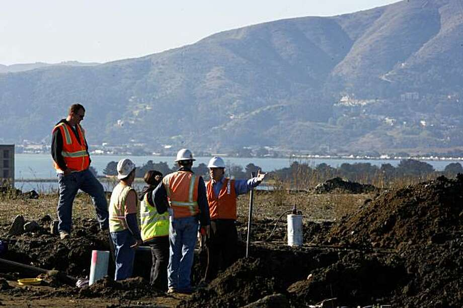 Working on the storm and sanitary sewer lateral installation on the newly-developed land that Lennar Corp. plans to build houses on, next to Hunters Point Shipyard in San Francisco, Calif., on Monday, November 2, 2009. Photo: Liz Hafalia, The Chronicle