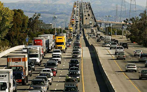 West bound highway 92, (left)  slows as commuters, at mid-morning, cross over the high rise section of the San Mateo Bridge into Foster City, Calif, on Wednesday October 28, 2009, after an earlier repair to the Bay Bridge, failed Tuesday night shutting down the span into San Francisco. Photo: Michael Macor, The Chronicle