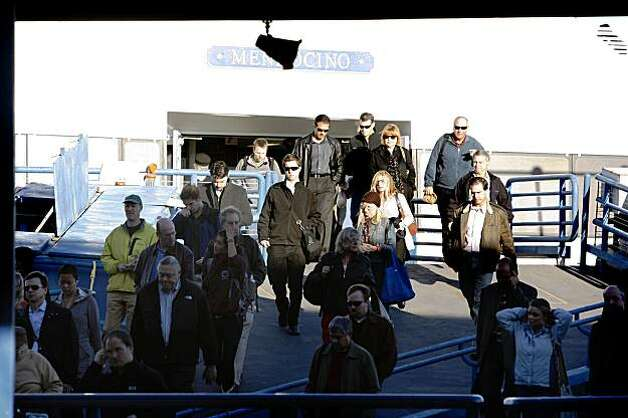 Passengers disembark from a Golden Gate Ferry at the Ferry Building in San Francisco, Calif. on Wednesday October 28, 2009. Photo: Lea Suzuki, The Chronicle