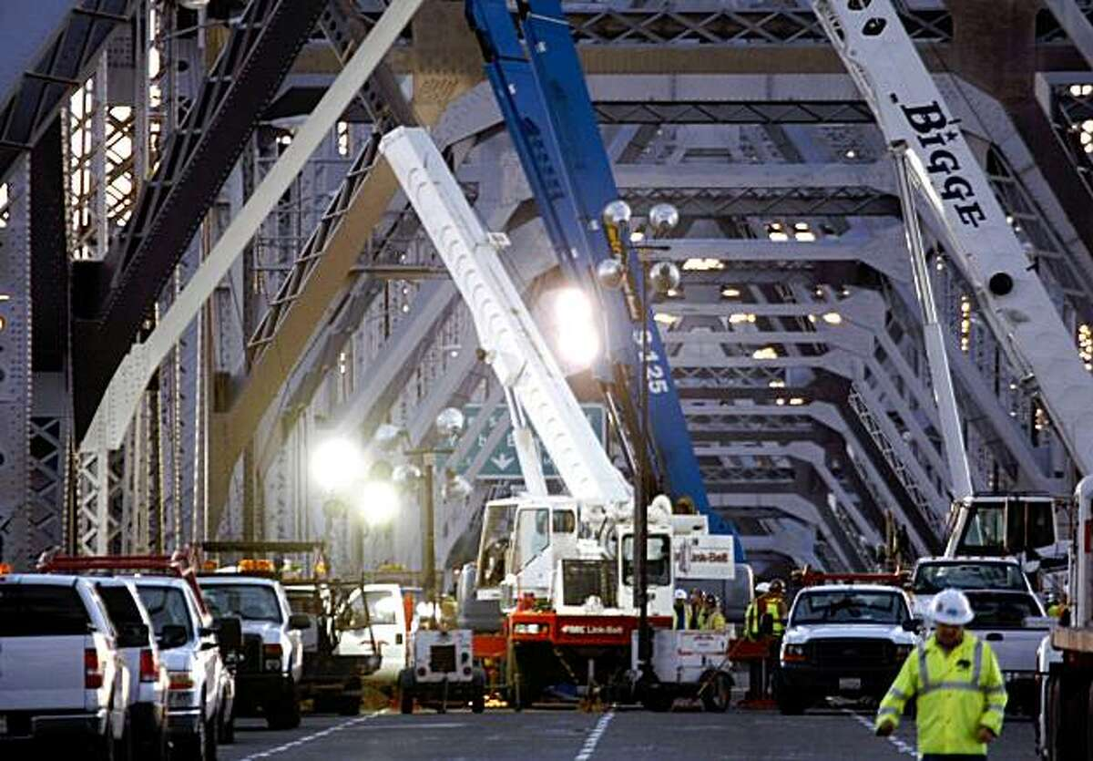 Crews work on the saddle and tie-rods that failed on the Bay Bridge.