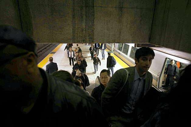 The morning after  the Bay Bridge was closed indefinitely for repairs, commuters flood BART's Embarcadero Station on Wednesday. Photo: Mike Kepka, The Chronicle