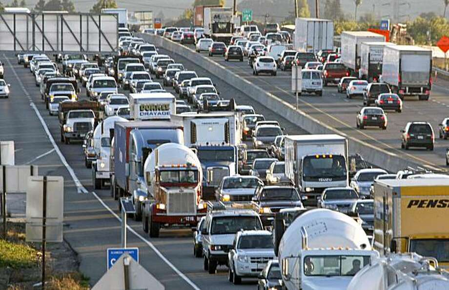 West bound traffic approaching the San Mateo Bridge toll booths from Hayward is backed up for miles due to the closer of the Bay Bridge Wednesday morning. Photo: Lance Iversen, The Chronicle