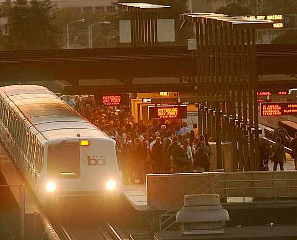 Commuters unload at Rockridge BART in Oakland, Calif., while emergency repairs on the Bay Bridge continue. Photo: Noah Berger, Special To The Chronicle