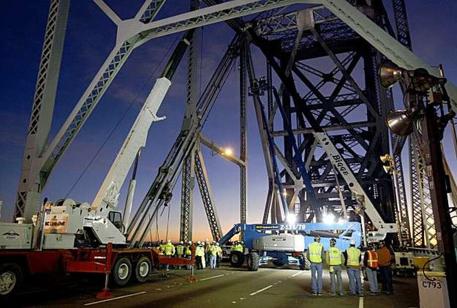 Iron workers and construction personnel continue to make repairs to the saddles on the Bay Bridge. Photo: Lance Iversen, The Chronicle