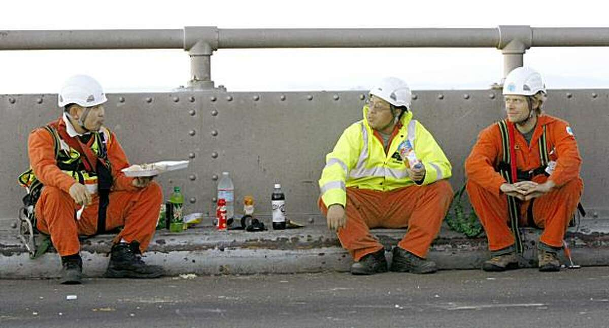 Cal-Trans inspectors take a dinner break on the Bay Bridge as the re-repair of the saddle continued Friday Oct 30, 2009.