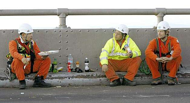 Cal-Trans inspectors take a dinner break on the Bay Bridge as the re-repair of the saddle continued Friday Oct 30, 2009. Photo: Lance Iversen, The Chronicle