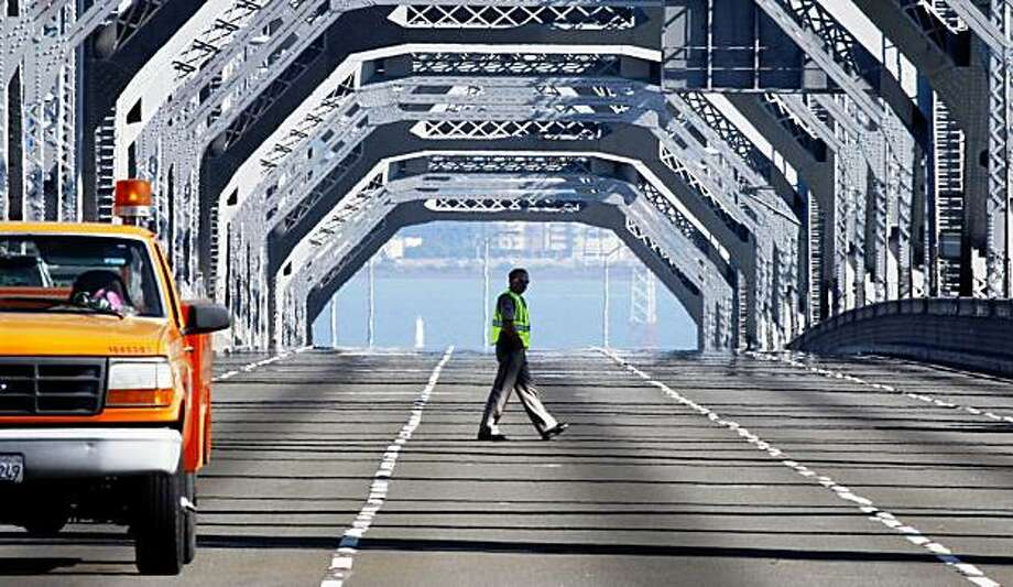 A CHP Officer walks on the upper deck of the closed Bay Bridge as the Re-Repair of the Bay Bridge continued Sunday Nov. 01, 2009 Photo: Lance Iversen, The Chronicle