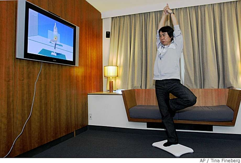 "Nintendo game designer Shigeru Miyamoto, creator of Wii Fit, does a yoga pose as he demonstrates the game, Thursday April 17, 2008 in New York.  ""Our main premise in creating Wii Fit was (to) create a game that allows you to check your weight,"" said Miyamoto. (AP Photo/Tina Fineberg) Photo: Tina Fineberg, AP"