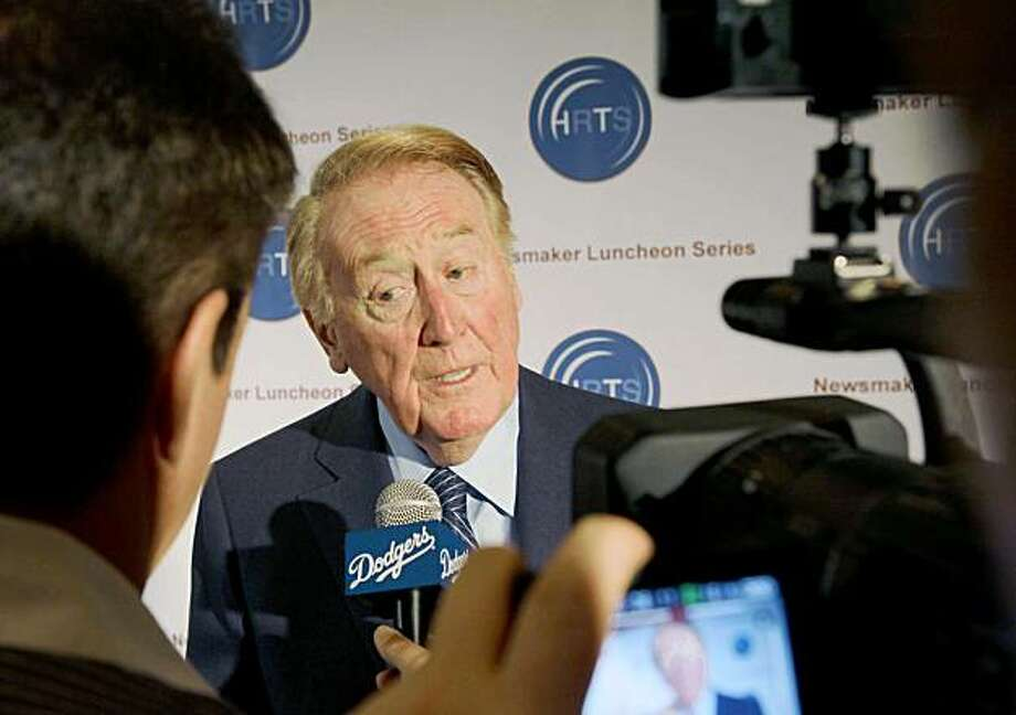 Vin Scully, the play-by-play announcer for the Los Angeles Dodgers, speaks to media during the Hollywood Radio and Television Society's Newsmaker Luncheon Tuesday Nov. 10, 2009 in Beverly Hills, Calif.  Scully says he will continue in the broadcast booth for the Los Angeles Dodgers through the 2010 season, then decide whether he will walk away. (AP Photo/Nick Ut) Photo: Nick Ut, AP