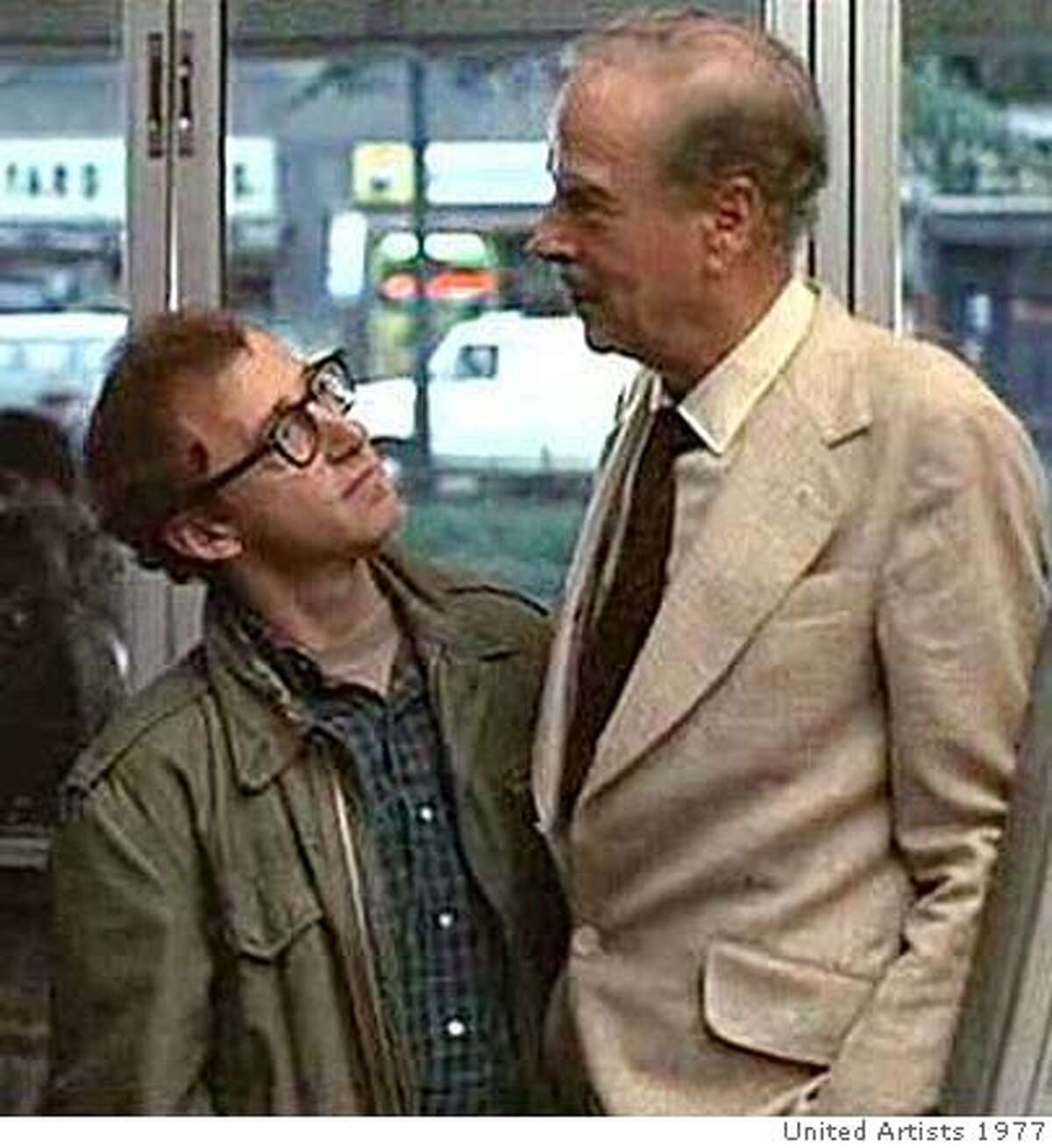 Unknown actor, left, Woody Allen and Marshall McLuhan in ANNIE HALL
