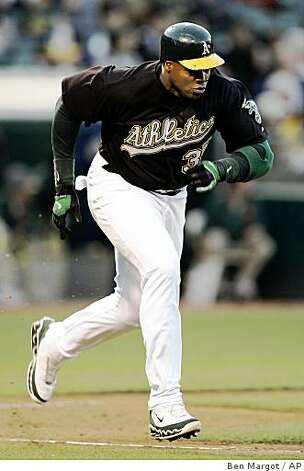 Oakland Athletics' Frank Thomas runs after hitting a double off Toronto Blue Jays' A.J. Burnett during the third inning of a baseball game Tuesday, May 27, 2008, in Oakland, Calif. (AP Photo/Ben Margot) Photo: Ben Margot, AP