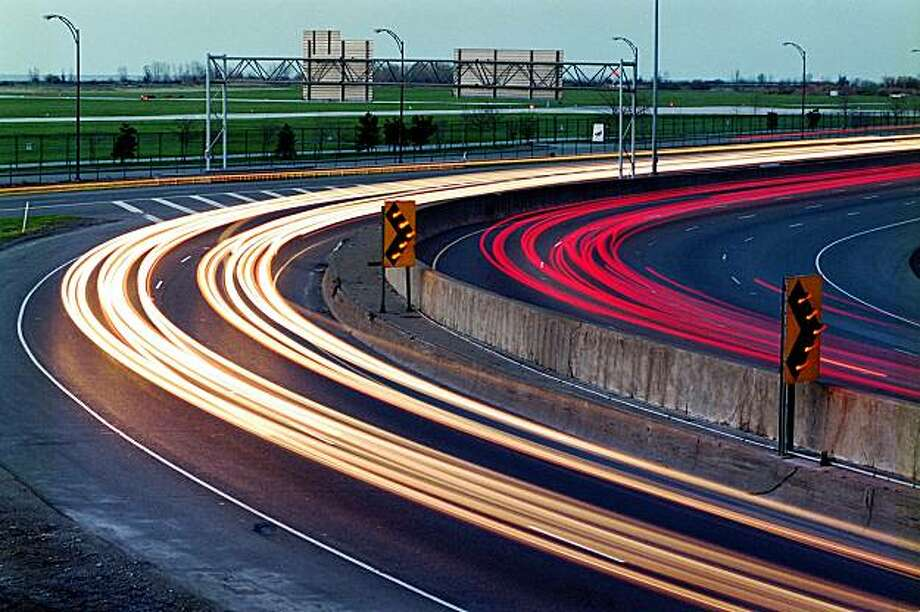 The Ohio Department of Transportation would like to straighten the sharp turns at Dead Man's Curve on the Inner Belt but might be unable to. In this time-exposure shot, streams of vehicle headlights and taillights trace the dangerous curves on April 18, 2001. Photo: Mike Levy, Cleveland Plain Dealer