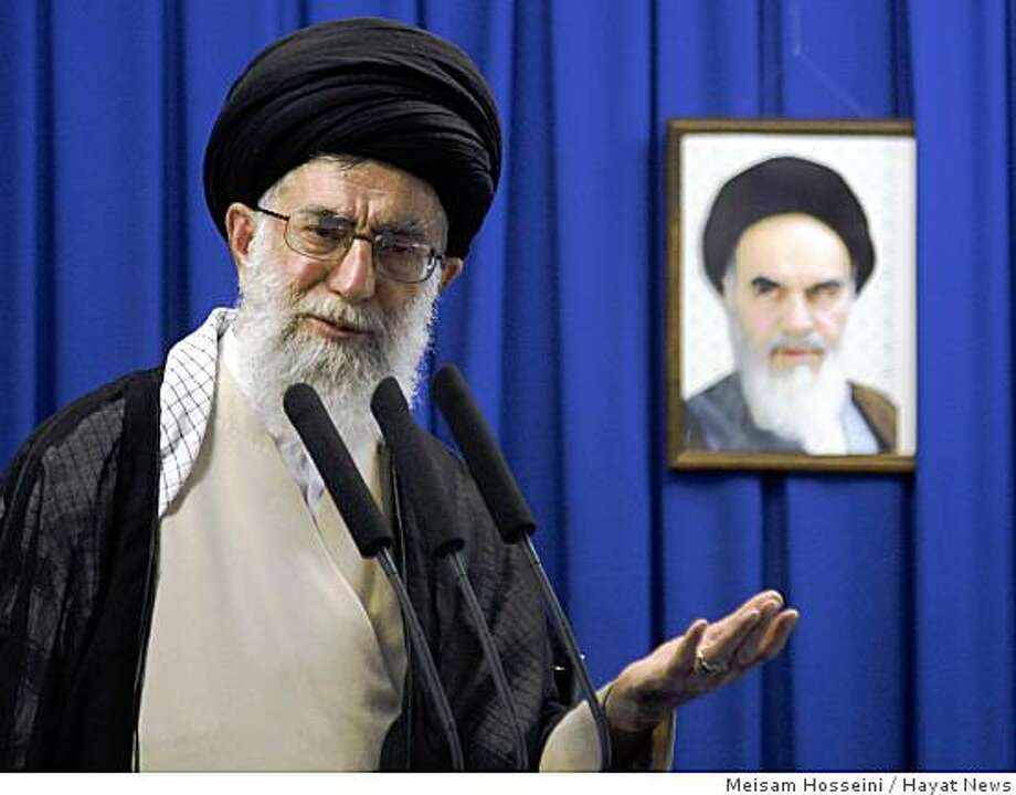 Iran's Supreme Leader Ayatollah Ali Khamenei, delivers his sermon in front of a picture of the late spiritual leader Ayatollah Khomeini, during the Friday prayers, at the Tehran University campus, in Tehran, Iran, Friday, June 19, 2009. Photo: Meisam Hosseini, Hayat News