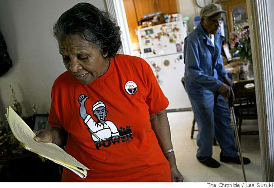 Esselene Stancil, left, who has lived in her home since 1965, looks over Proposition F flyers in San Francisco, Calif., on Wednesday, May 21 2008. Her husband Ben Stancil is in the background on the right. Photo: Lea Suzuki, The Chronicle