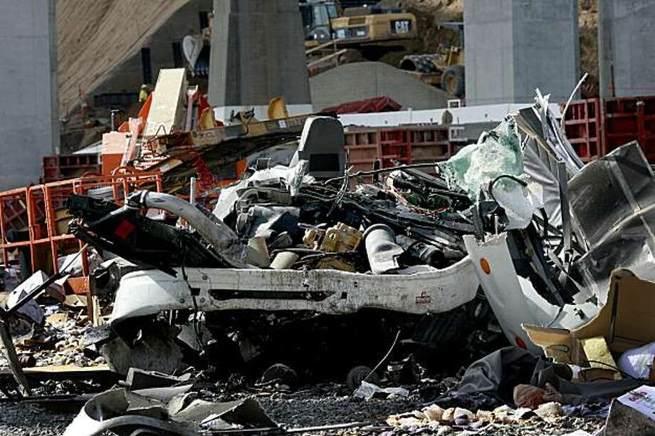 The cab of the truck lay crushed beneath the new S curve area of the Bay Bridge early Monday morning landing on Yerba Buena island and killing the driver November 9, 2009. Photo: Brant Ward, The Chronicle