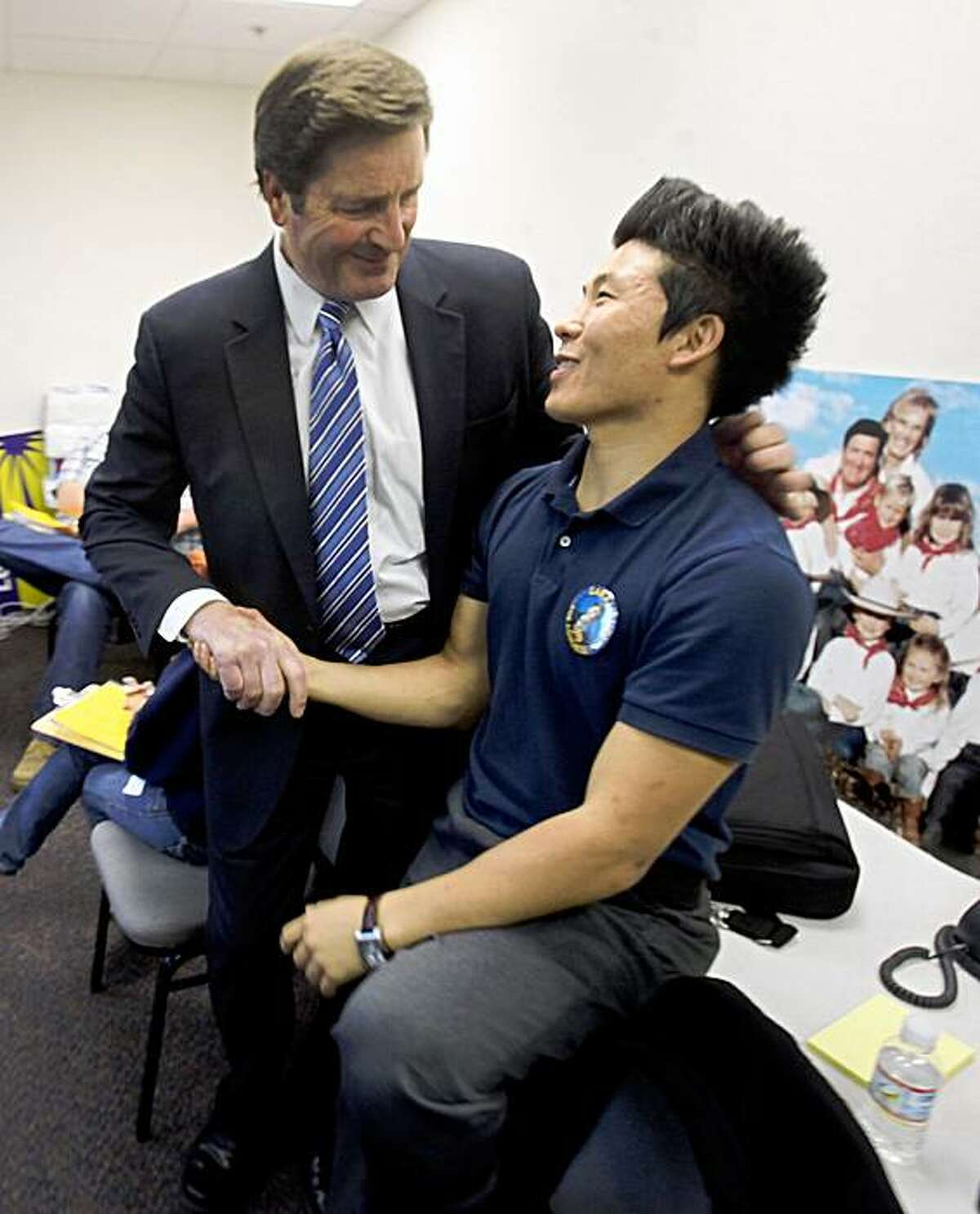 Lt. Gov. John Garamendi, the Democratic candidate for the 10th Congressional District, thanks Andrew Kim, right, his regional campaign director for his work during a visit to his campaign field office in Fairfield,on Tuesday. Garamendi is battling Republican David Harmer in Tuesday's special election to replace Rep. Ellen Tauscher, a Democrat, who was appointed to a State Department position earlier this year.