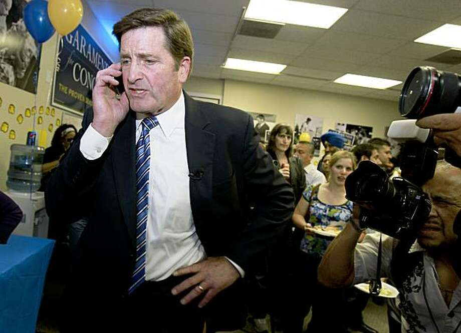 Garamendi spoke with the national press via cellphone about Republican victories in the east. Lt. Gov John Garamendi celebrated an early lead in the 10th Congressional district from his Walnut Creek campaign headquarters. Photo: Brant Ward, The Chronicle