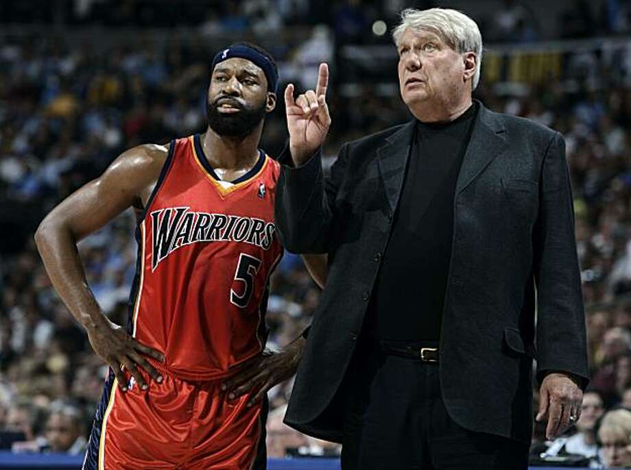 Golden State Warriors head coach Don Nelson, right, confers with guard Baron Davis during a break in play in the third quarter of the Denver Nuggets' 119-112 victory over the Warriors in an NBA basketball game in Denver on Saturday, March 29, 2008. Photo: David Zalubowski, AP