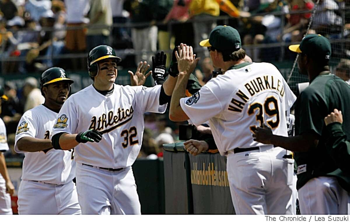 Athletics #32 Jack Cust (second from left) celebrates his homerun with teammates during the bottom of the seventh in Oakland, Calif. on Sunday, May 25 2008. Gregorio Petit #2 (left) also scored. Final Score of the game: Oakland 6 vs Boston 3.Photo By Lea Suzuki/ San Francisco Chronicle