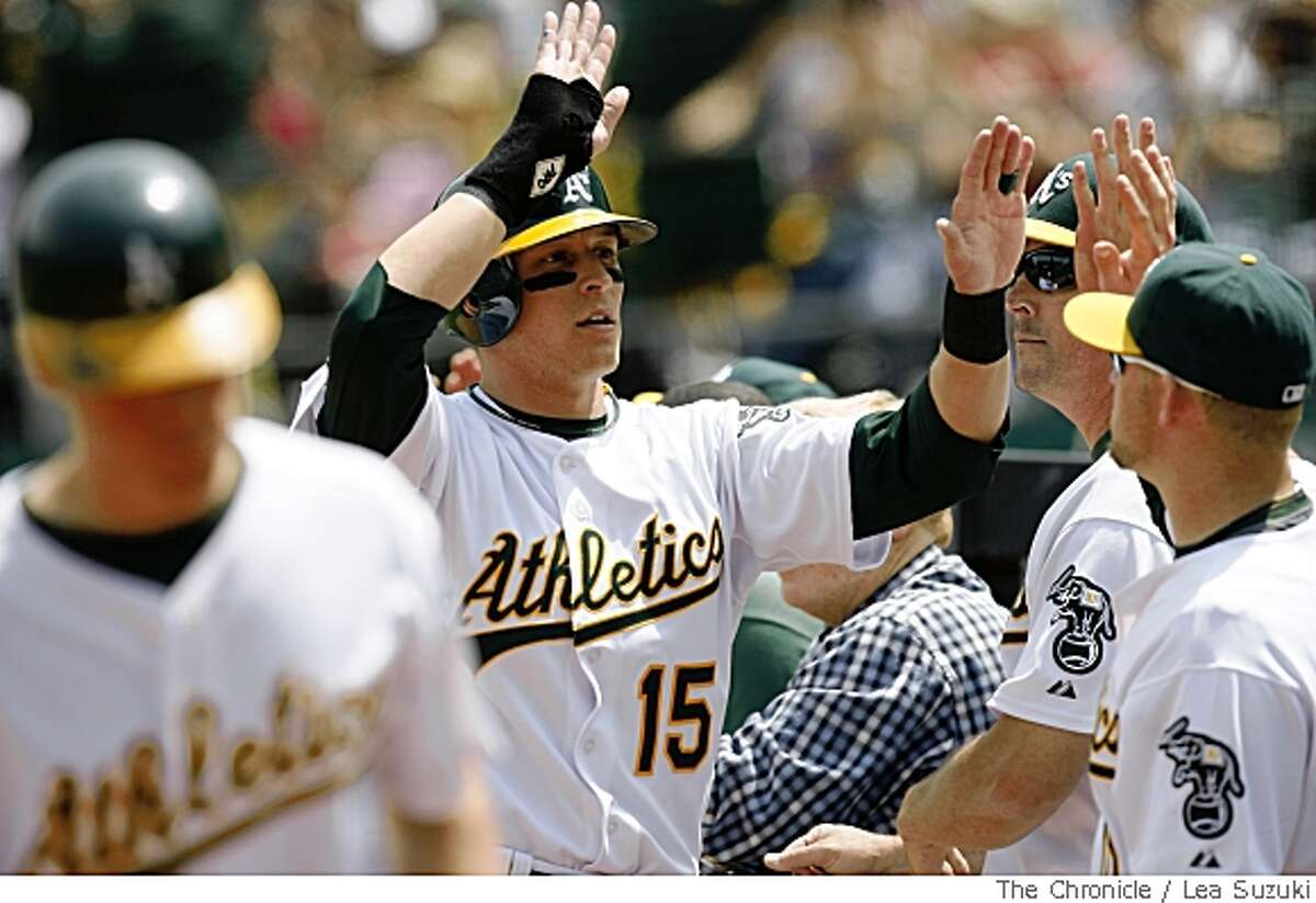Mark Ellis celebrates his score on Jack Hannahan's single to center in the bottom of the fourth in Oakland, Calif. on Sunday, May 25 2008 during the Oakland Athletics vs Boston Red Sox game. Final Score of the game: Oakland 6 vs Boston 3.Photo By Lea Suzuki/ San Francisco Chronicle
