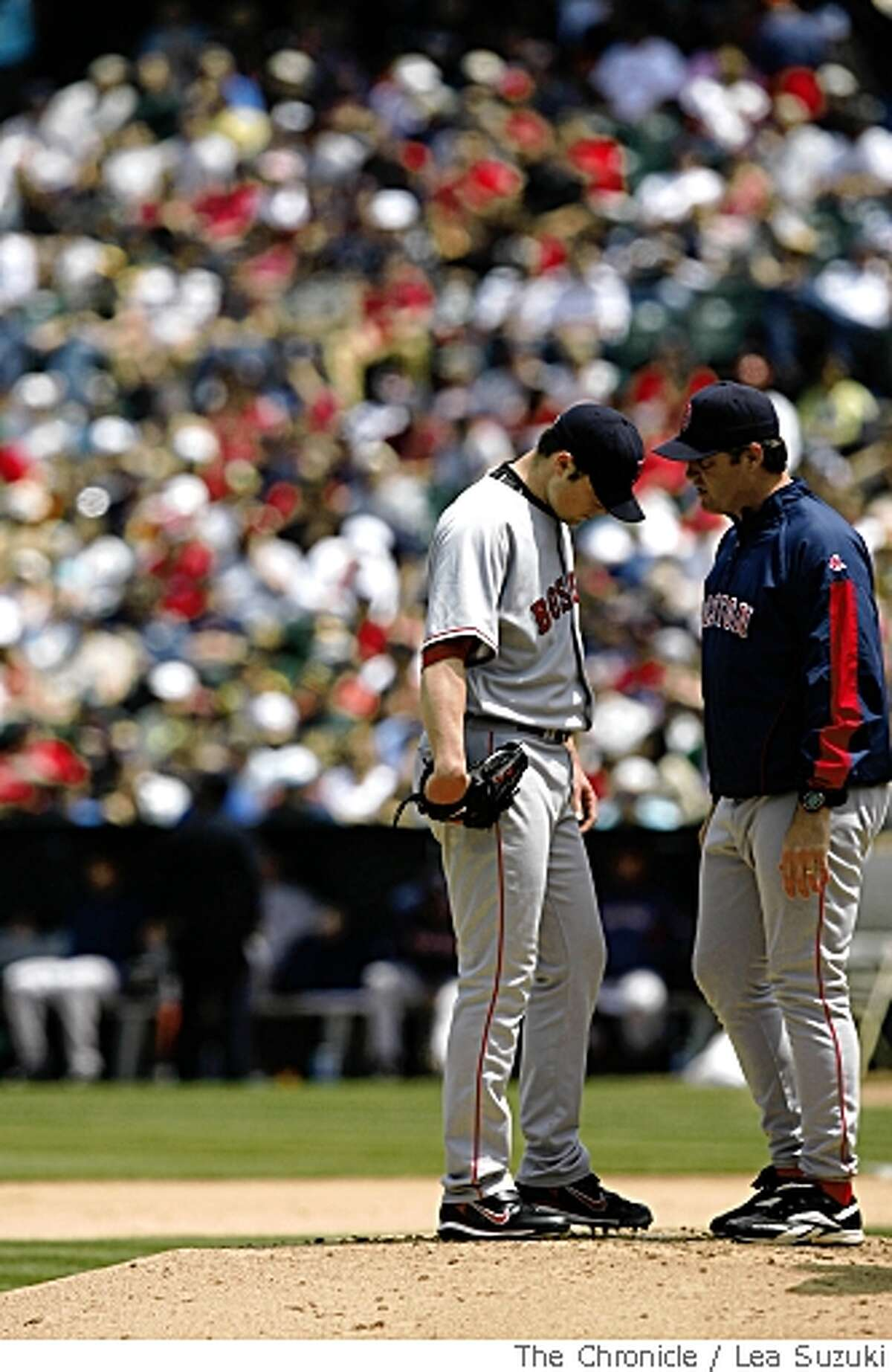 Pitcher Jon Lester (left) in a discussion on the mound in the bottom of the fourth in Oakland, Calif. on Sunday, May 25 2008 during the Oakland Athletics vs Boston Red Sox game. Final Score of the game: Oakland 6 vs Boston 3.Photo By Lea Suzuki/ San Francisco Chronicle